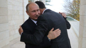 Russian President Vladimir Putin, left, embraces Syrian President Bashar Assad at the Bocharov Ruchei residence at the Black Sea resort of Sochi, Russia (Mikhail Klimentyev / AP)