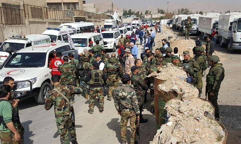 Russian forces accompanying Syrian regime forces at the entrance to the al-Wafddien Camp, Douma (Sputnik)