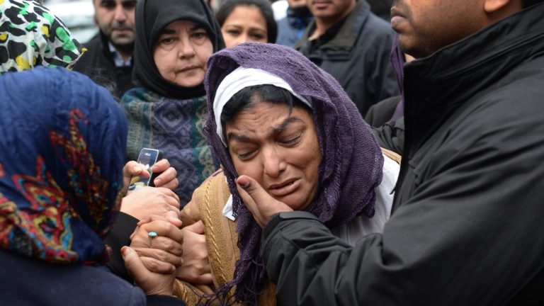Fatma Khan, mother of British surgeon Abbas Khan during his mourning service - 26 December, 2013 (PA)