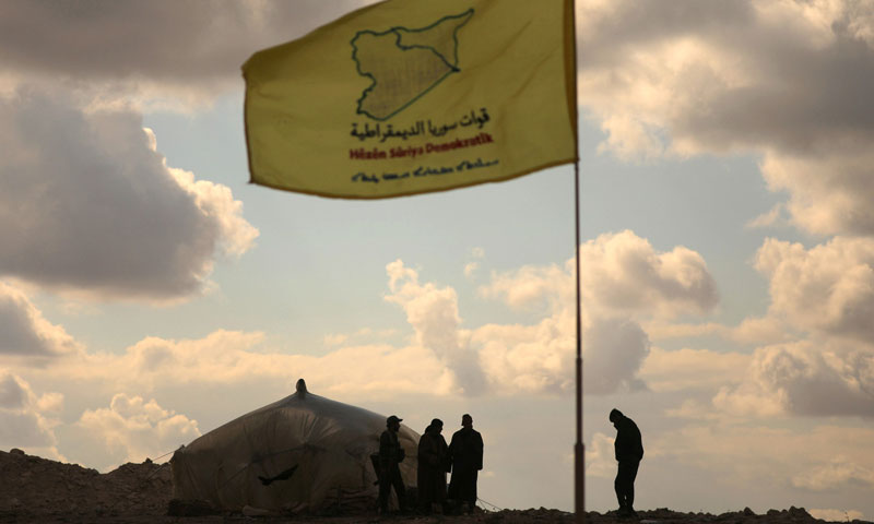 Fighters of the Syrian Democratic Forces (SDF) standing together near the Bāghūz, Deir ez-Zor – February 11, 2019 (Reuters)