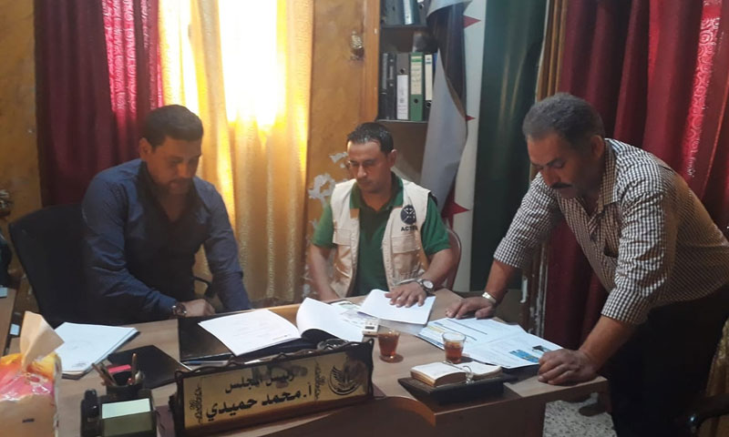 Signing a Memorandum of Agreement on Cash for Work project between Dabiq's Local Council and ACTED Organization - August 2019 (Dabiq Local Council)