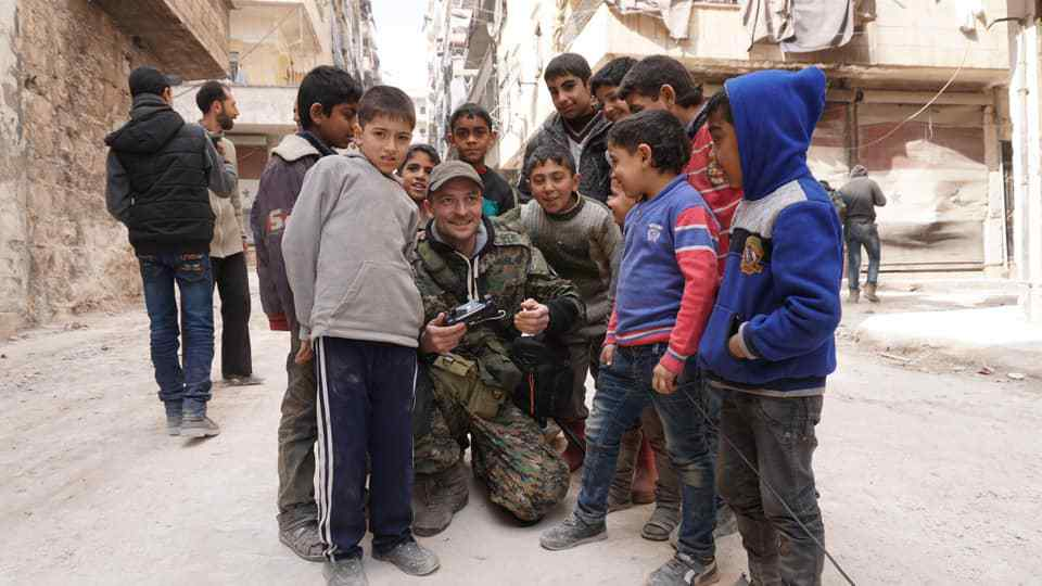 Journalist working for the Russian news agency ANNA News, Aleksandr Kharchenko, surrounded by a group of Syrian children - Aleksandr Kharchenko Facebook account - April 26, 2019.