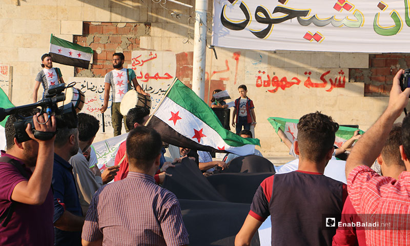 Demonstration held at the Clock Square in Idlib city, demanding the liberation of Khan Shaykhun and offsetting the Syrian regime – September 16, 2019 (Enab Baladi)