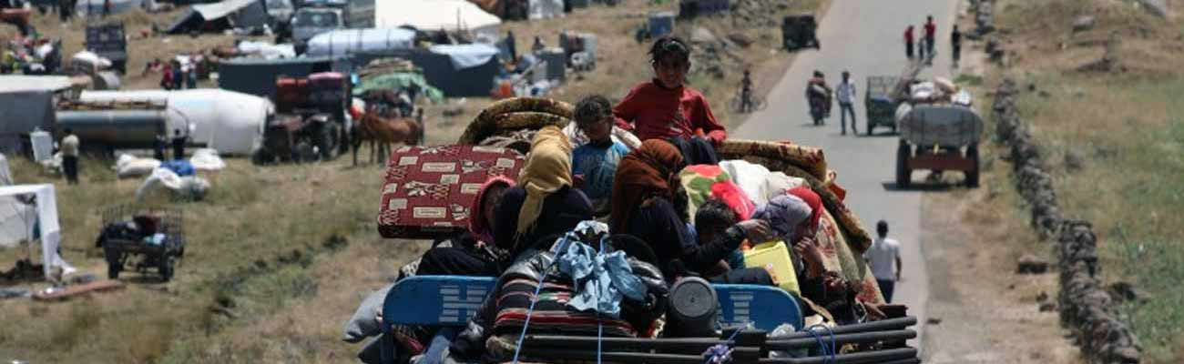 Displaced people from Daraa, southern Syria, during their displacement in June 2018 (Reuters)