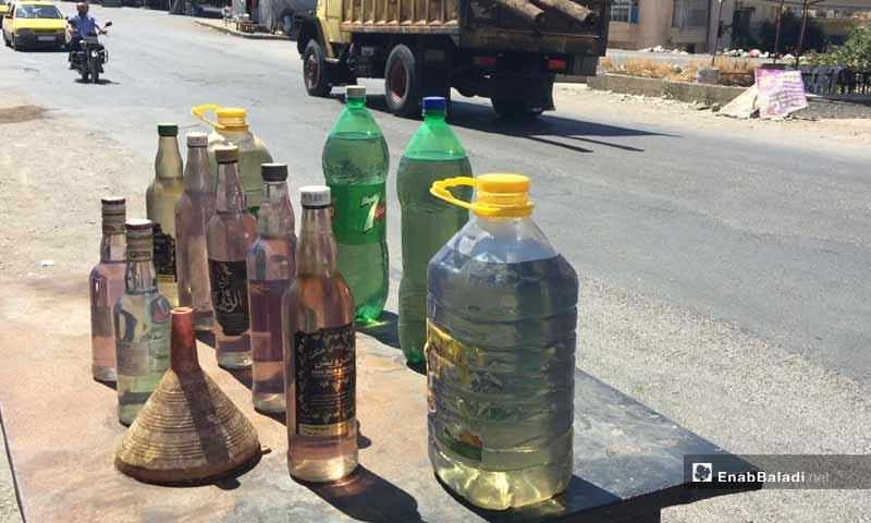 Fuel bottles for sale in Suwayda - 5 September 2019 (Enab Baladi)