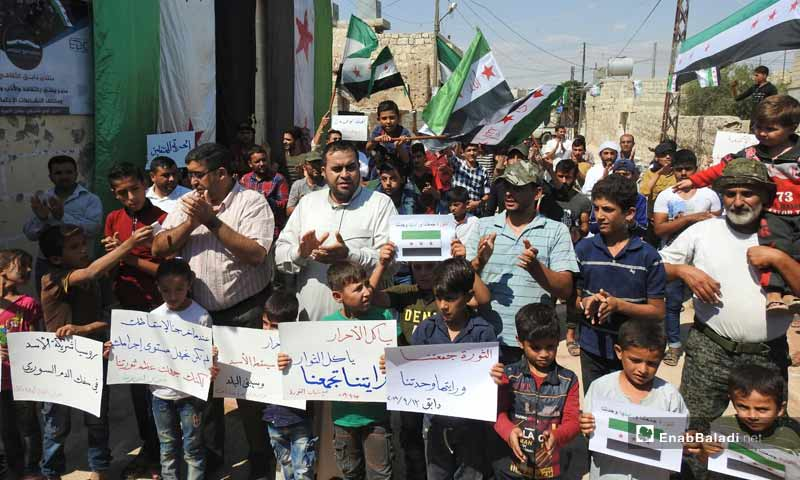 """Demonstrations in the towns of Dabiq, Binnish and  Kafar Takharim, rural Aleppo, on the Friday of """"Together We Are Brought by the Revolution and United by Its Flag We Stand"""".– September 13, 2019 (Enab Baladi)"""