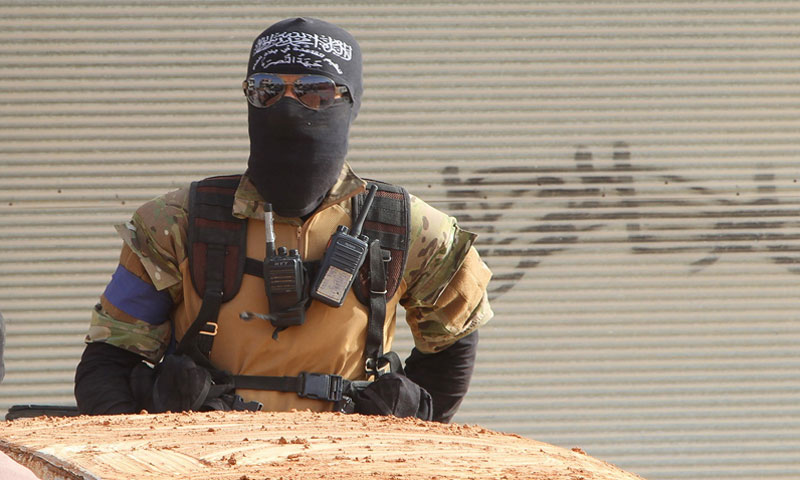 A fighter of the al-Nusra Front getting prepared to participate in a battle in Idlib – 2015 (Reuters)