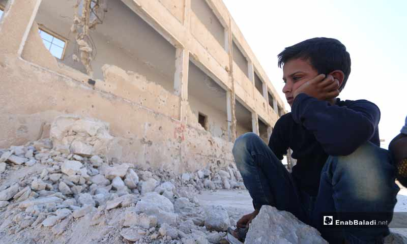 A photo for children sitting over the ruins of the Binnish school destroyed by the shelling- September 27, 2019 (Enab Baladi)