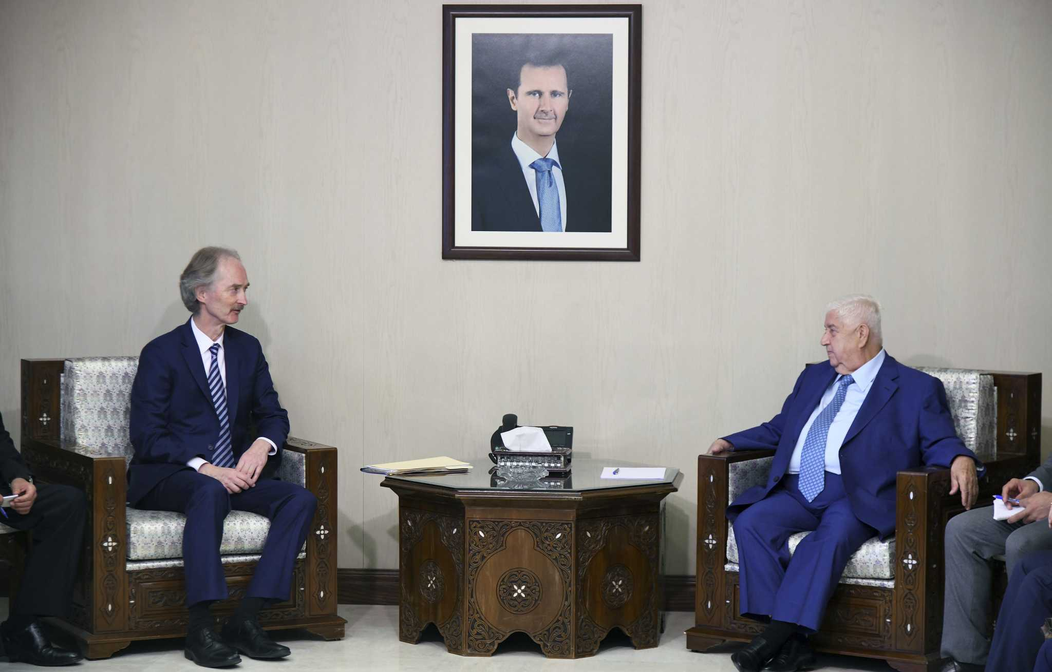 UN envoy to Syria Geir Pederson and Syrian Foreign Minister Walid al-Moallem in Damascus - September 2019 (Reuters)