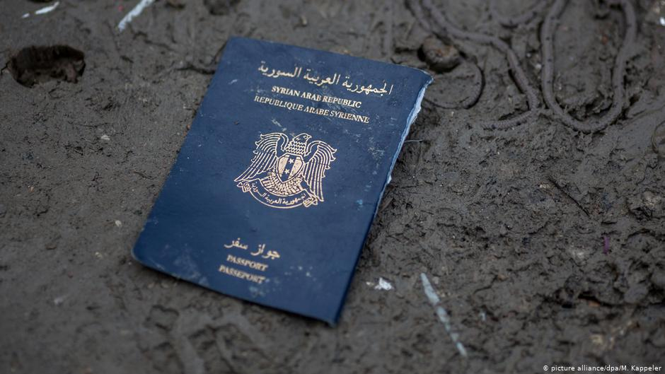 A piece of Syrian passport thrown in rubbish in a refugee camp on the border between Greece and Macedonia, March 4, 2016 (AP)
