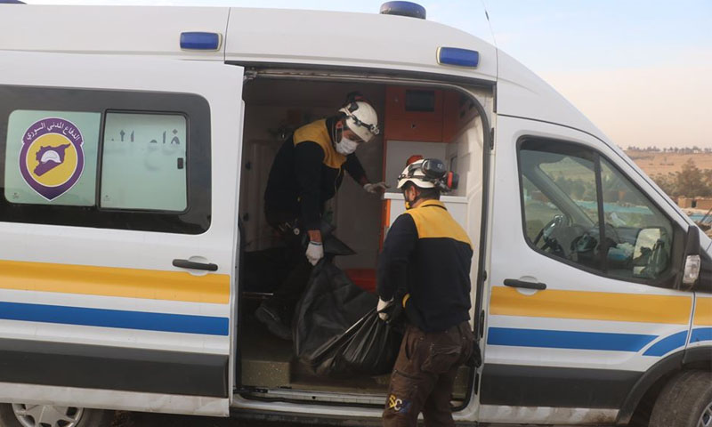 Syrian Civil Defense are picking up dead bodies in the village of Tarhin in eastern Aleppo - 26 November 2019 - (Syria's Civil Defense Facebook page)