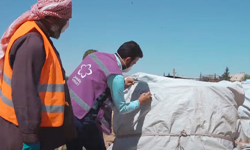 Violet Organization workers making compost in the province of Idlib- 23 October 2019 (Violet Organization)