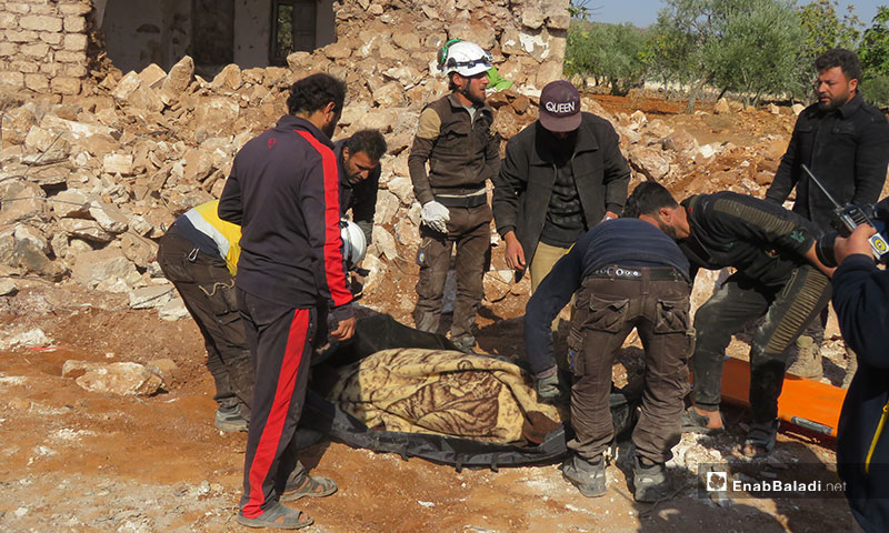 Pulling civilians from rubble in al-Malaja village in southern countryside of Idlib after being targeted by Russian airstrikes - 17 November 2019 (Enab Baladi)