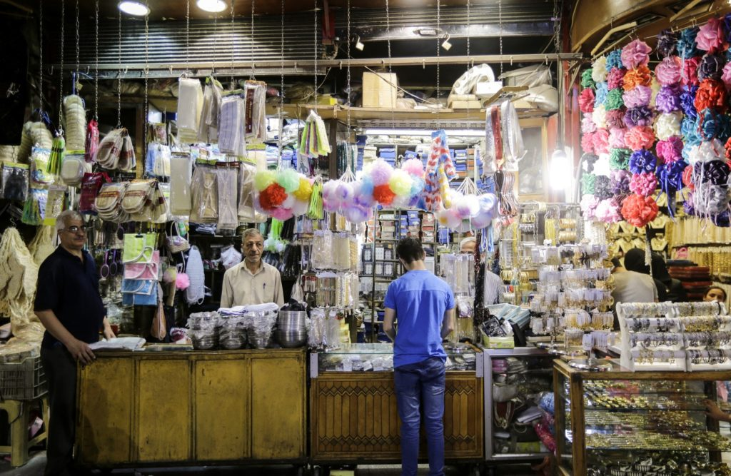 A merchant in al-Hamidiyah Souq selling household items, May 2019 (AFP)