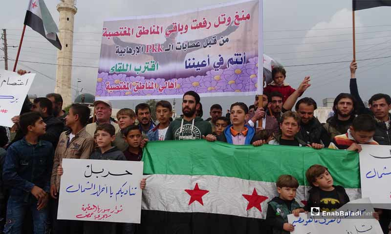Residents of Tell Rifaat holding a demonstration in the Karaj Sajou Square, near the Bab al-Salam crossing in the northern province of Aleppo - 1 November 2019 (Enab Baladi)