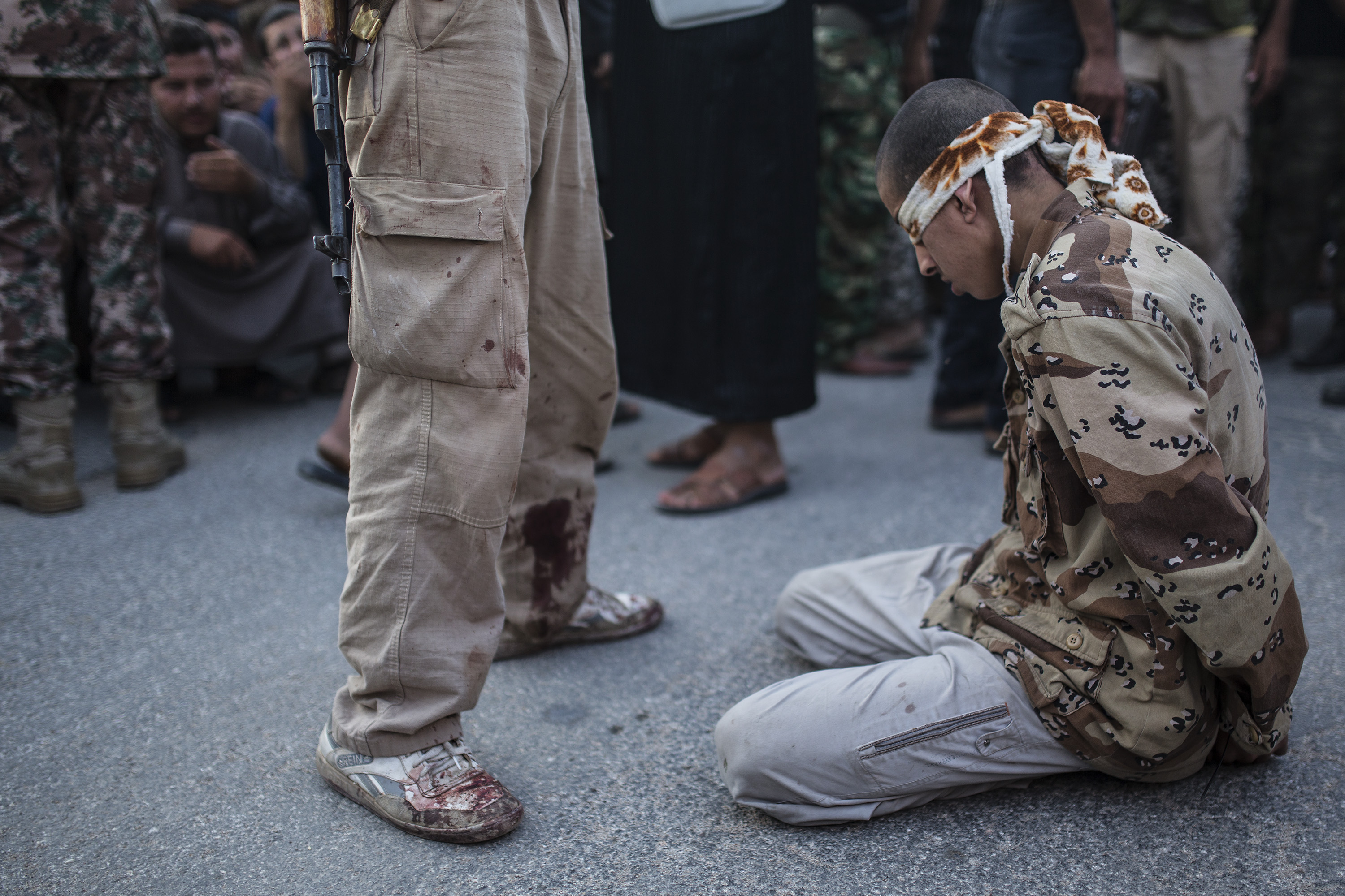 Syrian young man kneeling blindfolded before being executed by armed groups in Aleppo - August 13, 2013 (time)