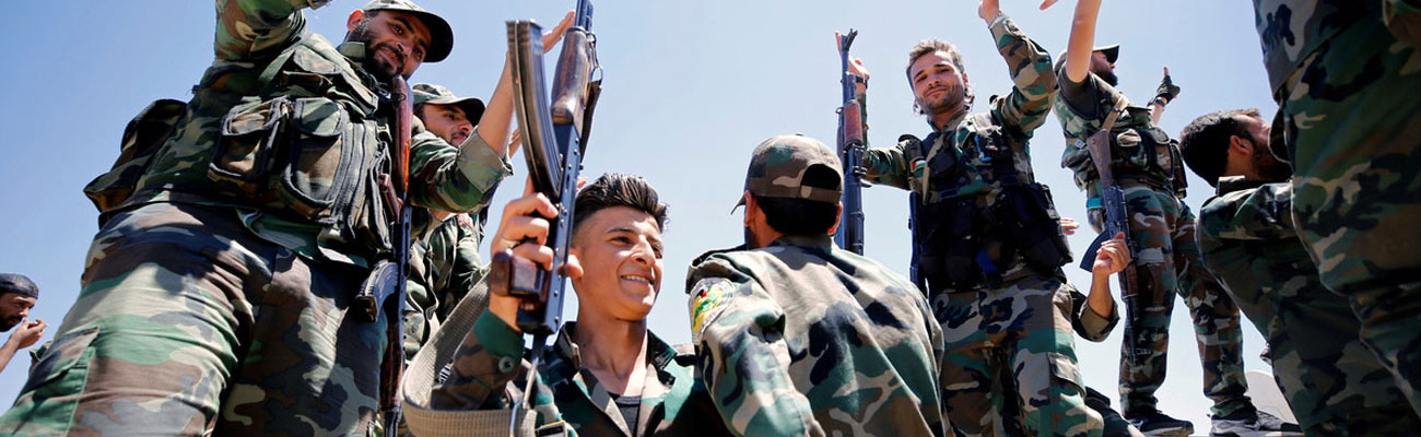 Members of al-Assad's forces during the military campaign in Quneitra - July 2018 (Reuters)