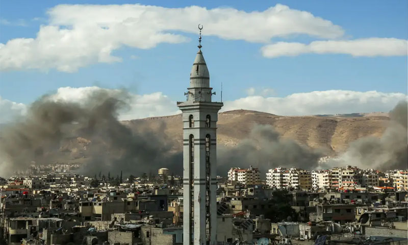 A view shows smoke rising during a bombardment carried out by the Syrian regime forces in neighborhoods of Douma city in Rif Dimashq province - 17 February 2018