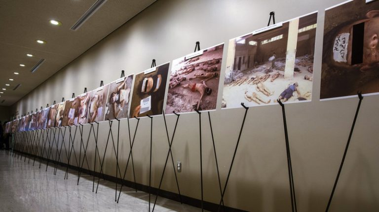 An exhibition of photos, which Caesar smuggled, of the bodies of detainees who died under torture in the cells of the Syrian regime prisons, at United Nations Headquarters - March 10, 2014 (Reuters).