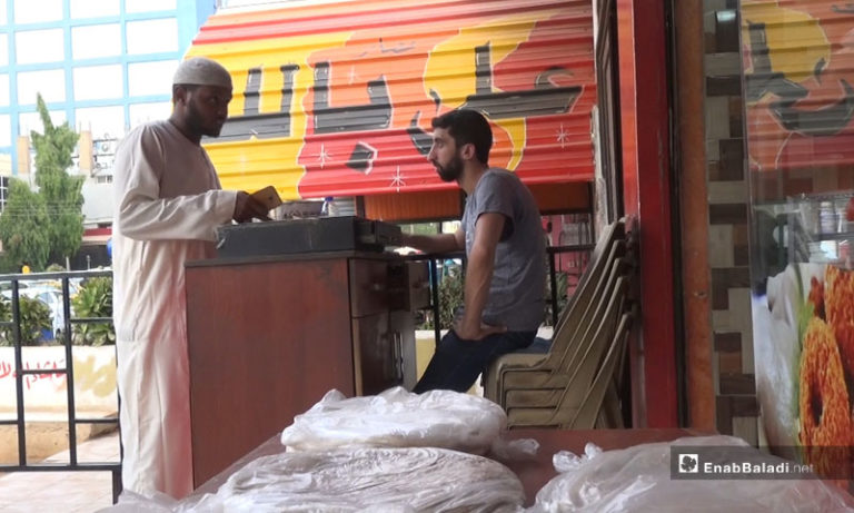 "A Sudanese citizen in a Syrian ""falafel"" store in Sudan - May 14, 2018 (Enab Baladi)"