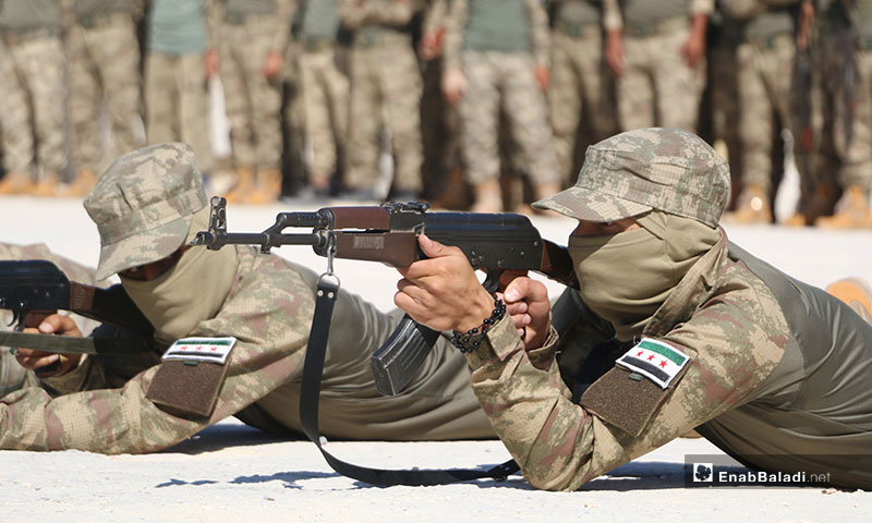 """The Syrian National Army rolling out a new military training with the purpose of joining the Turkish military offensive """"Operation Peace Spring"""" in the eastern region of the Euphrates - 11 October 2019 (Enab Baladi)"""
