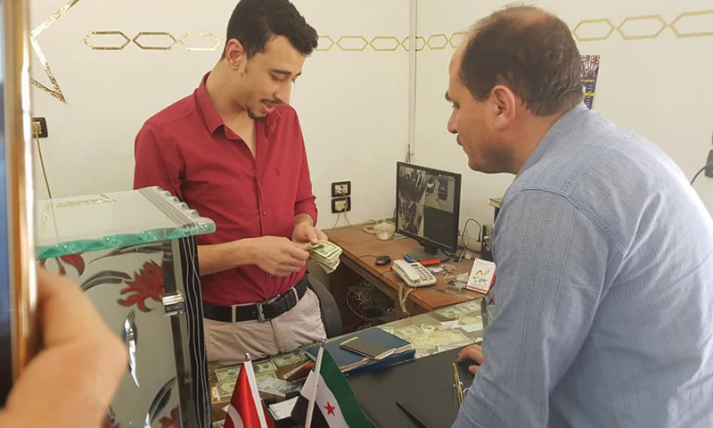 Exchanging USD to Turkish Lira in rural Aleppo to support it, 30 May 2018 (Facebook)
