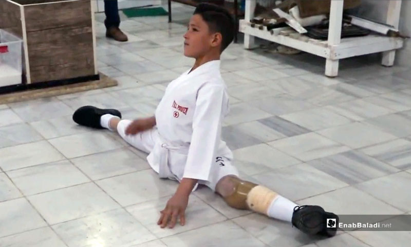 A boy exercising in the Center - December 14, 2019 (Enab Baladi)
