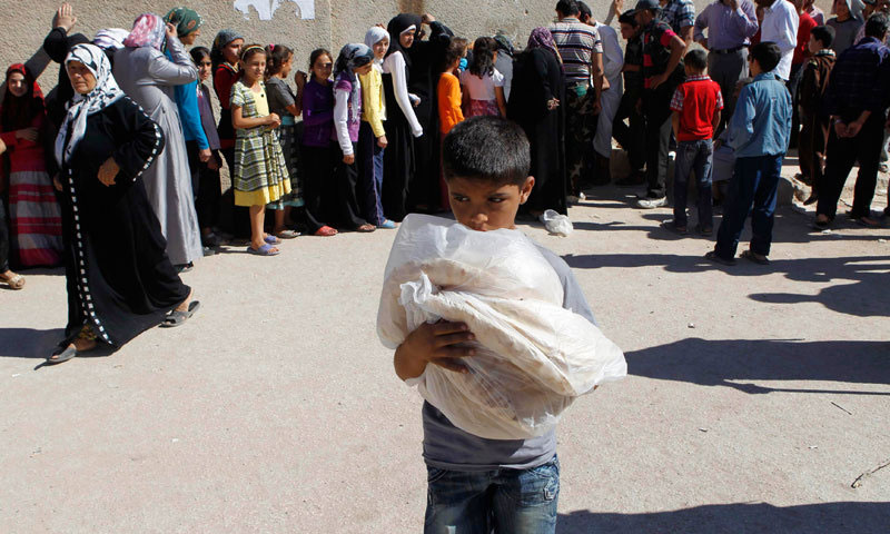 A child in bakery line for bread in Idlib Syria (Internet)