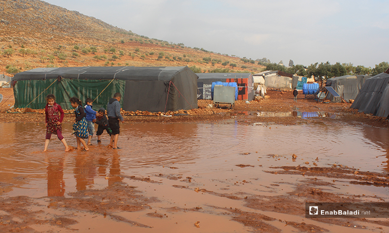 Heavy rains cut off the road to the camps of Sham 2, south-east of Killi village in rural Idlib - 5 December 2019 (Enab Baladi)