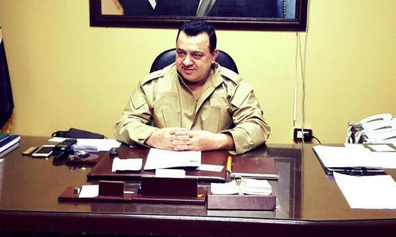 "A photo for the leader of ""Baath Commando"" Jihad Barakat in his office (Source: Masaken Barzeh News Network)"