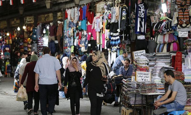 Citizens shopping in Al-Hamidiyah Souq in Damascus - 30 September 2019