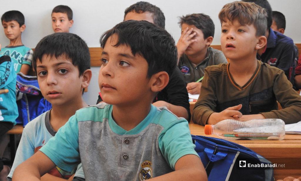 Children receiving education in a school in Idlib - 2019 (Enab Baladi)