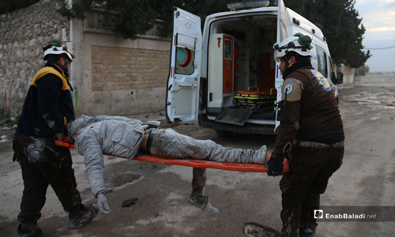 Members of the Syrian Civil Defense help victims of Russian and regime airstrike on the town of Kafr Naha in the western countryside of Aleppo - 21 January 2020 (Enab Baladi)