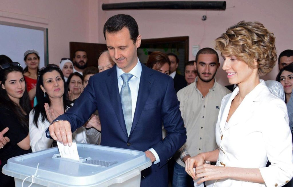 Syrian regime president Bashar al-Assad electing, accompanied by his wife in the 2014 presidential elections – February, 2014 (AP)