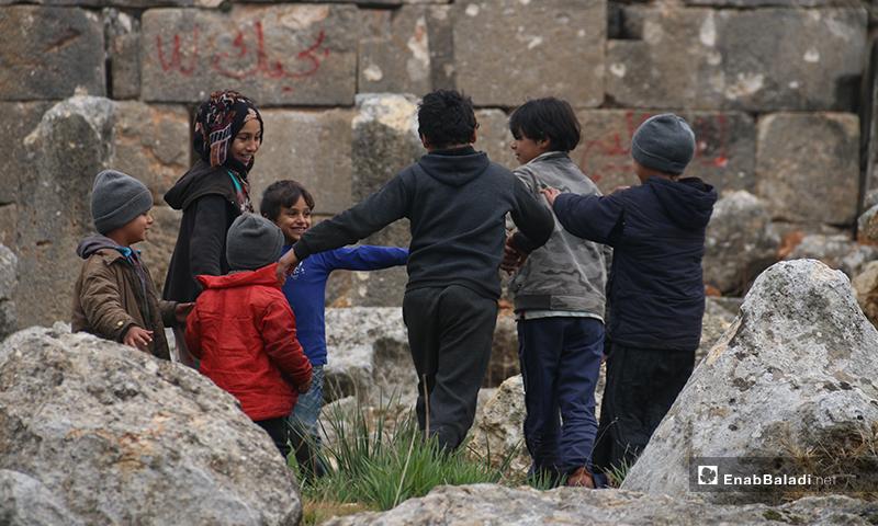 Children playing on Deir Amman ruins in the western countryside of Aleppo - 19 January 2019 (Enab Baladi)