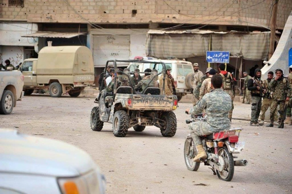 Members of the Syrian regime forces in the city of al-Bukamal, Deir Ez-Zor– November 21, 2017 (SANA)