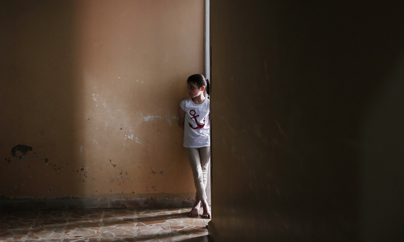 A girl standing in front of her room in an orphanage in Jarablus, northeastern Aleppo - 30 May 2018 (AP)