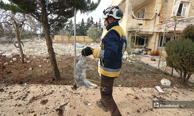 Syrian Civil Defence members inspect rubble at a site of Russian and regime bombing on western countryside of Aleppo -  18 January 2020 (Enab Baladi)