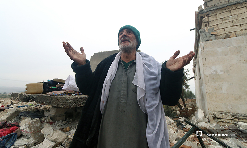 A man makes an appeal to God for mercy after his house was bombed in the town of Kafr Taal in the western countryside of Aleppo - 20 January 2020 (Enab Baladi)