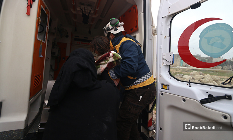 Members of the Syrian Civil Defence (White Helmets) help children and a family that were injured by the bomb on the town of Kafr Taal in the western countryside of Aleppo - 20 January 2020 (Enab Baladi)