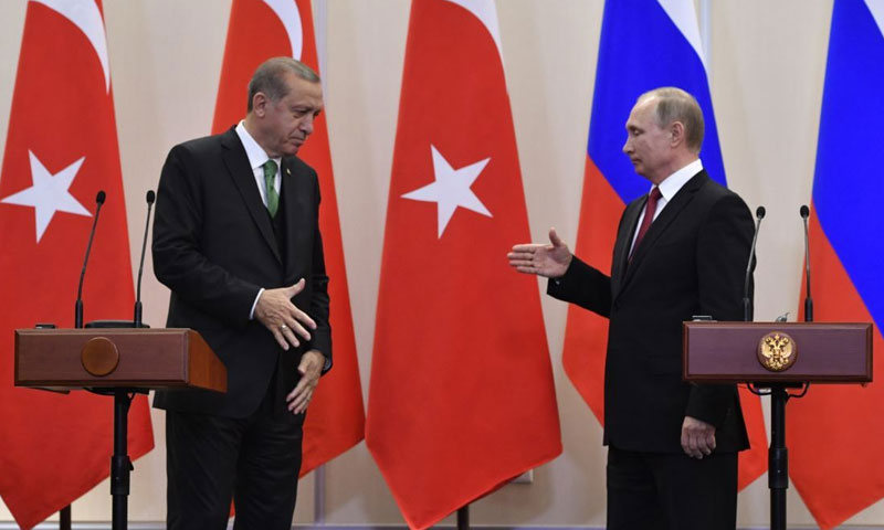 Turkish President Recep Tayyip Erdoğan and Russian President Vladimir Putin prepare to shake hands - 23 January 2019 (Pool Photo via AP)