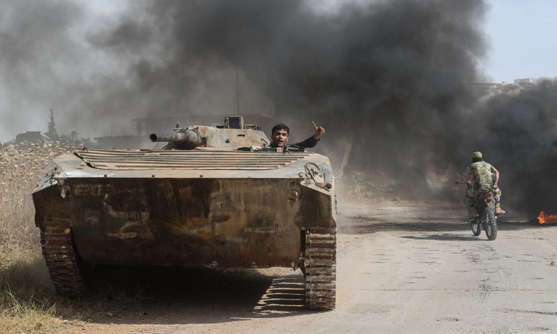 A tank belonging to the National Liberation Front in rural Hama - 6 June 2019 (AFP)