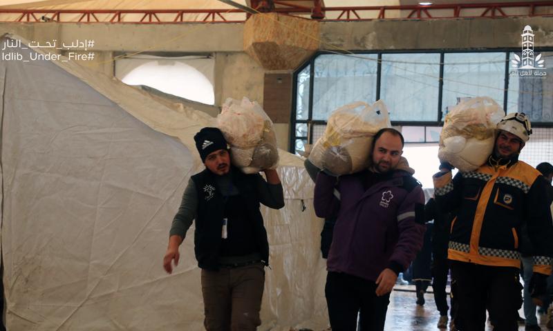 Volunteers of the People of Glory distributing food baskets (SCD Facebook)