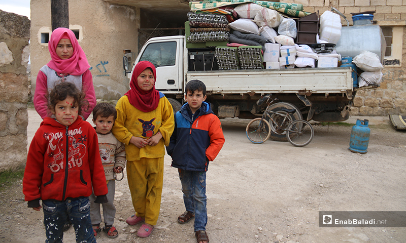 Children displaced from the southern countryside of Idlib to the countryside of Aleppo are preparing again to flee the area to escape the bombing - 16 January 2020 (Enab Baladi)