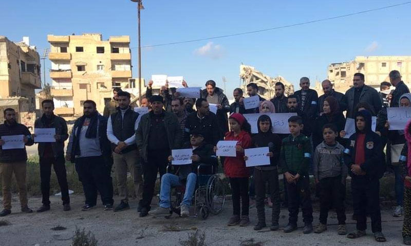 Solidarity stand for activists in the city of Raqqa, to condemn attacks on civilians in Idlib by government forces and their Russian allies, 1 January 2020 (Enab Baladi)