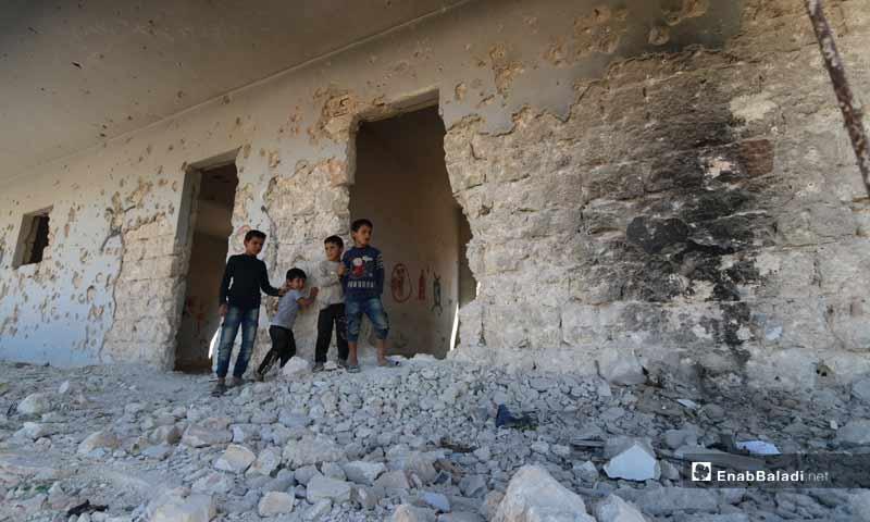Children at the destroyed school of Binnish as a result of the bombing - September 27, 2019 (Enab Baladi)
