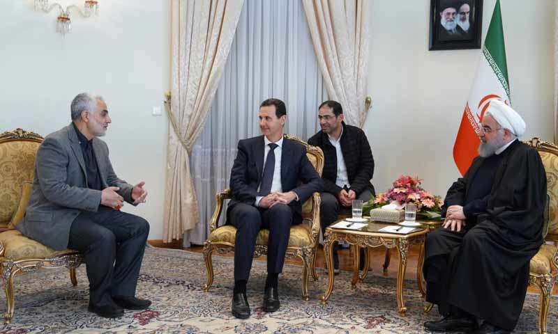 Syrian President Bashar al-Assad met with Iranian President Hassan Rouhani in the presence of the head of Iran's elite Quds Forces, Qassem Soleimani - 25 February 2019 (AFP)