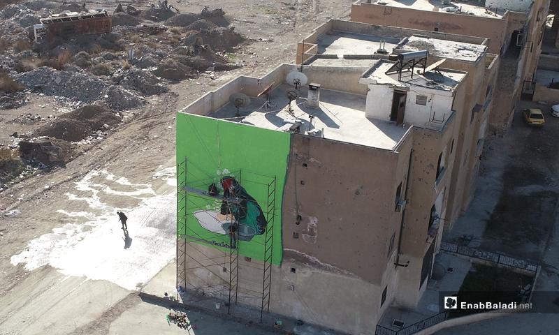 "Graffiti in Raqqa, within ""We Are Its Residents"" campaign (Enab Baladi)"