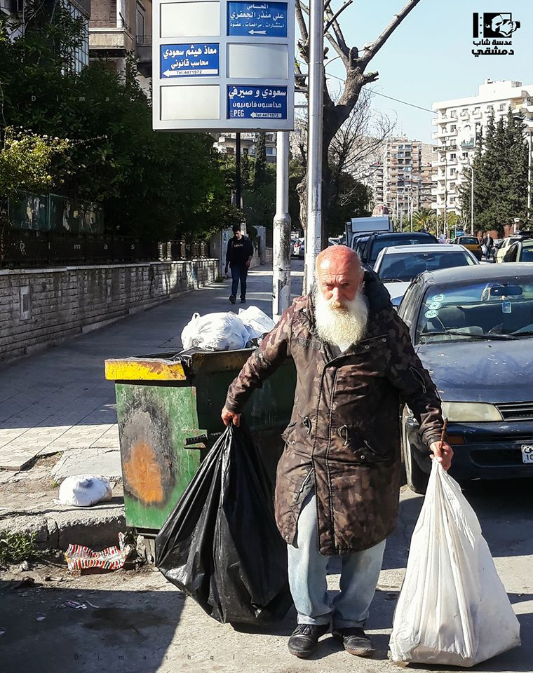 Citizen in front of a garbage container in al-Shahbandar area, central Damascus – October 25, 2019 (Lens Young Dimashqi)