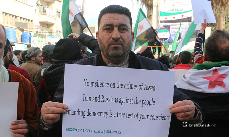 The residents of Idlib orgainzed a demonstration, condemning the Russian and Syrian regime bombing of Idlib and denouncing the failure of opposition factions to stave off the regime's progress - 31 January 2020 (Enab Baladi)